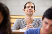 Smiling student listening to a lecturer — Stock Photo