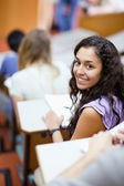 Portrait of a smiling student being distracted — Stock Photo