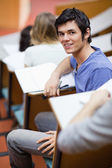 Portrait of a handsome young student being distracted — Stock Photo
