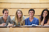 Smiling students working together — Stock Photo