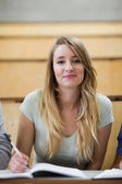 Portrait of a cute student holding a pen — Stock Photo