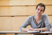 Male student holding a pen — Stock Photo