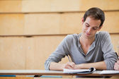 Male student writing notes — Stock Photo