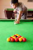 Portrait of a man playing snooker — Stock Photo