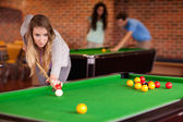 Woman playing snooker — Stock Photo