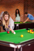 Portrait of a woman playing snooker — Stock Photo