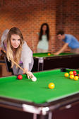 Portrait of a student woman playing snooker — Stock Photo