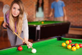 Cute woman playing snooker — Stock Photo