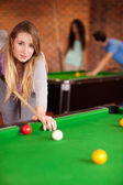Portrait of a young woman playing snooker — Stock Photo
