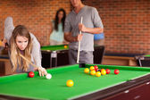 Friends playing snooker — Stock Photo