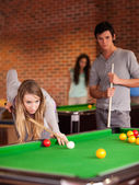 Portrait of friends playing snooker — Stock Photo