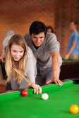 Portrait of a couple playing snooker — Stock Photo