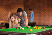 Couple playing snooker — Stock Photo