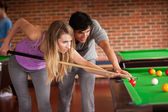Young couple playing snooker — Stock Photo
