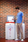 Portrait of a young man recycling — Stock Photo