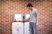 Young man recycling — Stock Photo