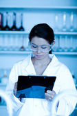 Portrait of a scientist taking notes — Stock Photo