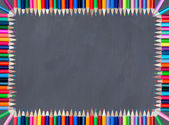 Blackboard framed with colored pencil — Stock Photo