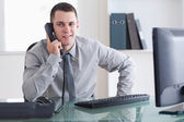 Businessman listening carefully to caller — Stock Photo