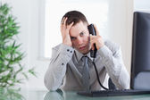 Close up of businessman getting sad news on the phone — Stock Photo