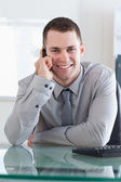 Businessman getting a pleasant call — Stock Photo