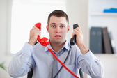 Overextended with the telephone — Stock Photo