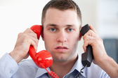 Close up stressed with the telephone — Stock Photo