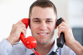 Close up handling the telephone stress smiling — Stock Photo