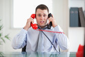 Businessman unable to cope the telephone — Stock Photo