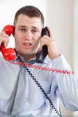 Close up of businessman troubled by the telephone — Stock Photo