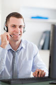 Close up of smiling call center agent speaking with costumer — Stock Photo