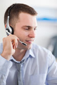 Close up of call center agent solving a costumers problem — Stock Photo