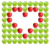 Green wet apples with red apples shaping a heart in between — Stock Photo