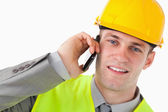 Close up of a young builder making a phone call — Stock Photo