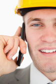 Close up of a smiling architect making a phone call — Stock Photo