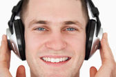 Close up of a happy man listening to music — Foto de Stock