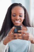 Close up of happy woman reading text message — Stock Photo