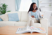 Woman with her laptop on the sofa — Stock Photo
