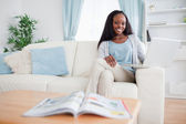 Woman with her notebook on the sofa — Stock Photo