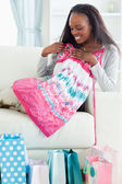 Close up of woman with her shopping on sofa — Stock Photo