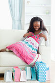 Woman on couch with new dress — Stockfoto