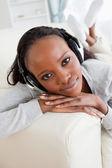 Close up of woman on sofa enjoying music — Stock Photo
