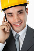 Close up of smiling architect listening to caller — Stock Photo