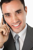 Close up of smiling young businessman on the phone — Stock Photo