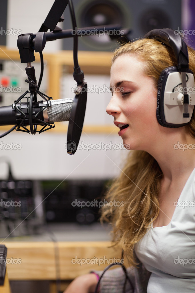 Portrait of a singer recording a track in a studio — Stock Photo #11192627