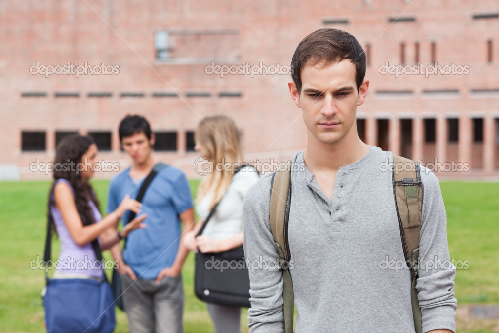 Lonely Student Feeling Excluded On Campus Stock Photo | Thinkstock