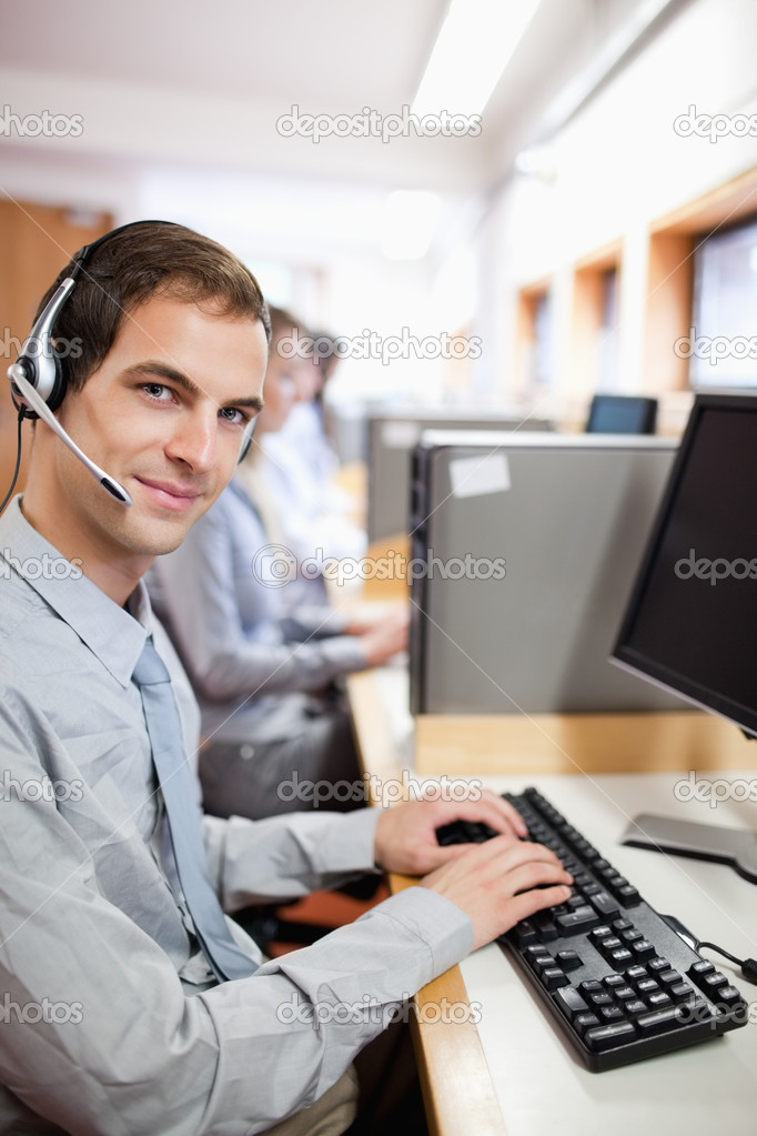 Portrait of an assistant using a computer in a call center — Stock Photo #11193988