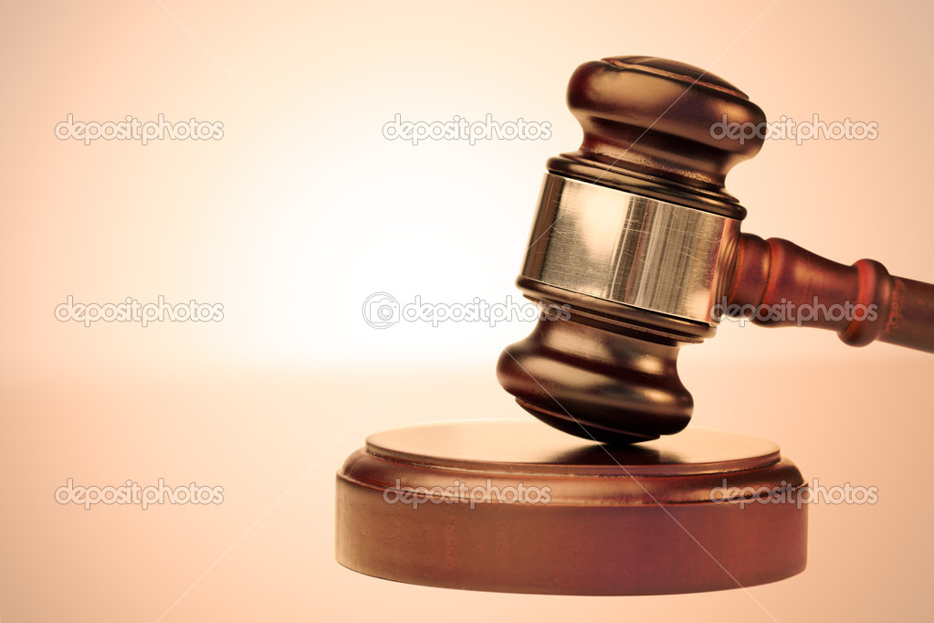 Close up of a brown gavel against a lighted background — Stock Photo #11194428