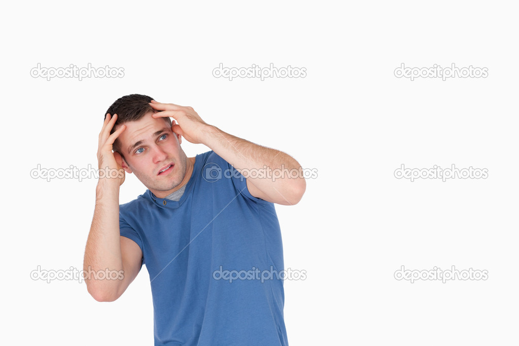 Man being afraid of something against a white background  Stock Photo #11196519