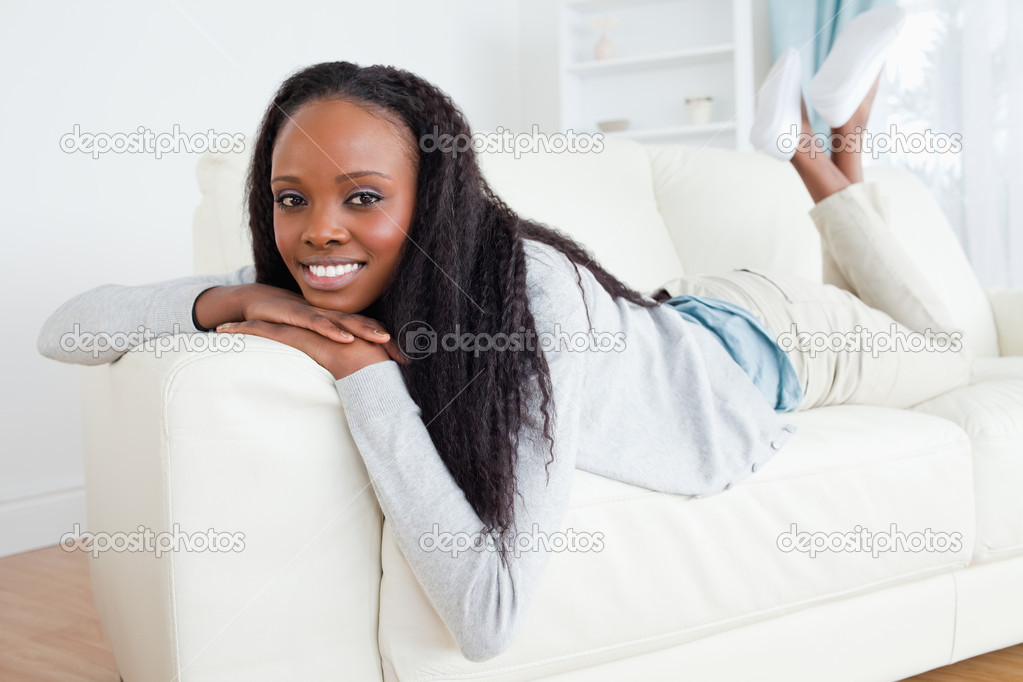 Smiling woman having a moment of relaxation on sofa  Stock Photo #11198148
